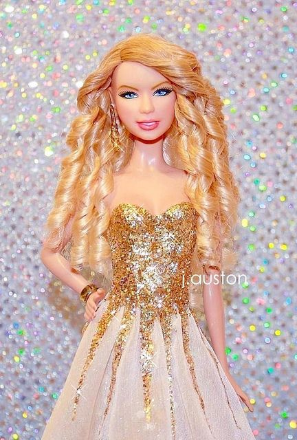 taylor swift barbie doll. in one of my favorite award show dresses. i kind of need this in my life.