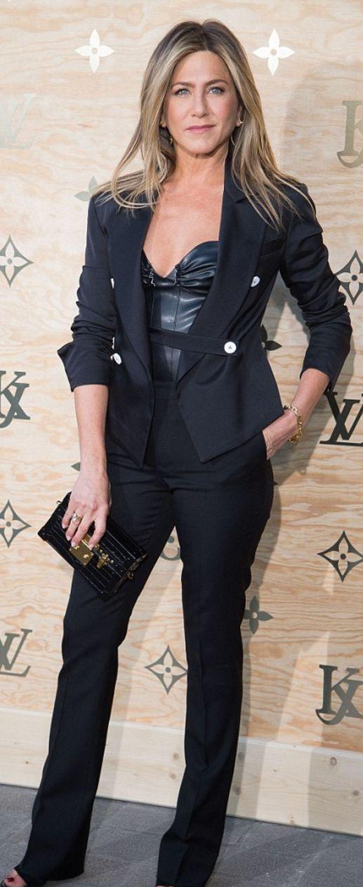 Who made  Jennifer Aniston's black pants, jacket, sweetheart top, and clutch handbag?