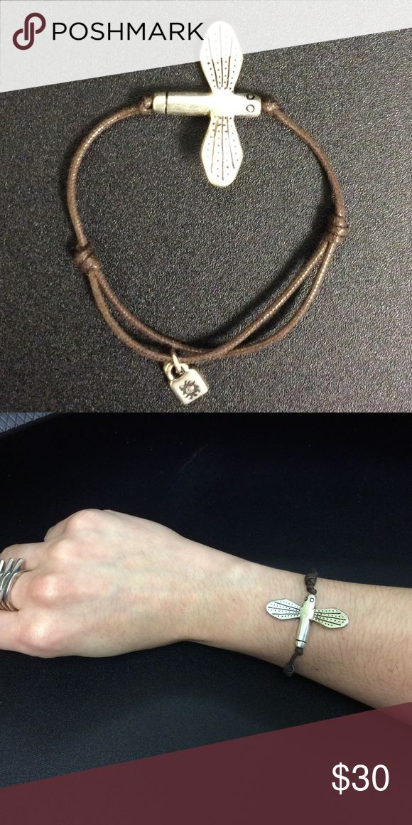 """Dragonfly on chocolate brown cord Bracelet Adjustable to fit any size wrist. This piece looks great on its own or layered with others. Dragonflies symbolize, """"new beginnings."""" This would make a great gift for a loved one starting a new journey. Uno De 50 Jewelry Bracelets"""