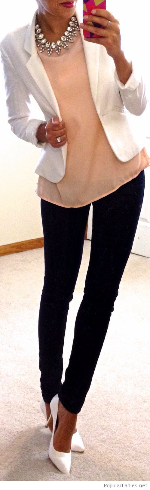 Nude top, black pants and white details