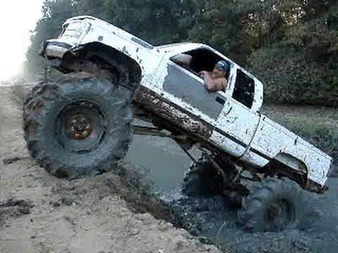 Mud truck chevy silverado 4x4 on tractor tires climbs for Big tractor tires for free