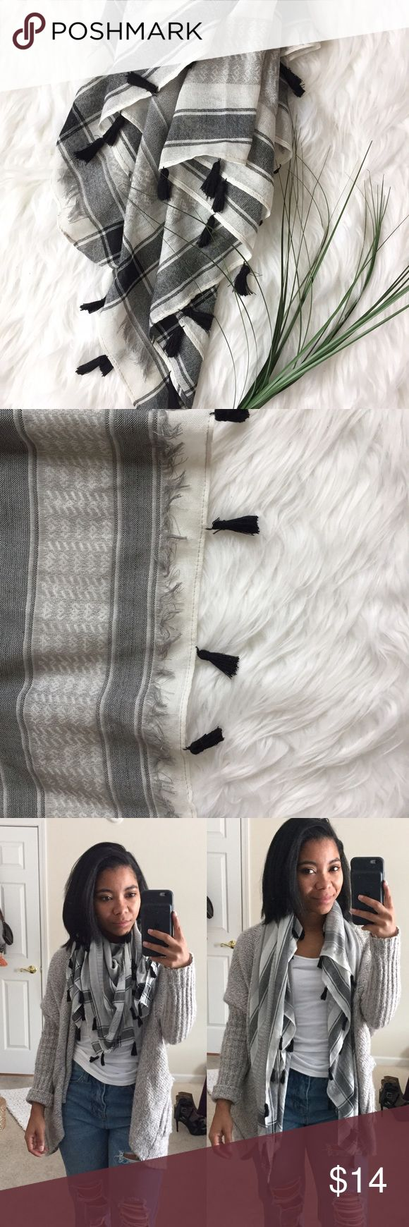 Boho Tassle Scarf A gorgeous square boutique blanket scarf with tassel details around all four edges. Pre-loved in great condition! Minor snags but not noticeable when worn. The colors are white, grey, and black. 42 inches x 42 inches. Accessories Scarves & Wraps