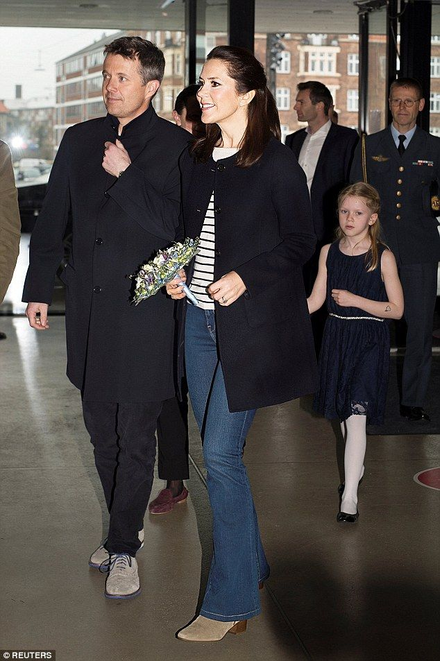 Casual cool: Mary chose to keep it casual for the regatta, wearing blue jeans, a striped top and a black coat
