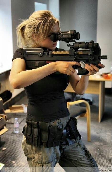 Belgian FNH , P-90 5.7 x 28mm submachinegun.  Futuristic looking personal defense weapon with a horizontal 50-round magazine.
