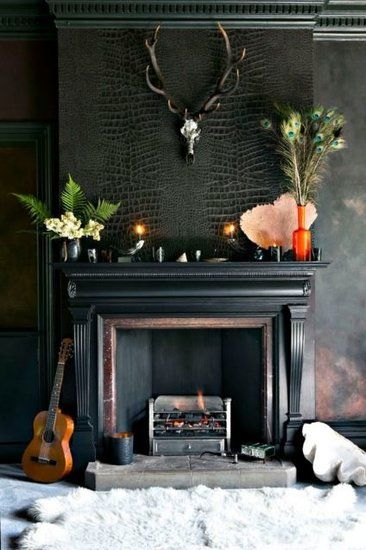 PIN 10 - A lovely crocodile faux leather wall feature. A great way to add interest and texture and looks great paired with the dear head and plants.