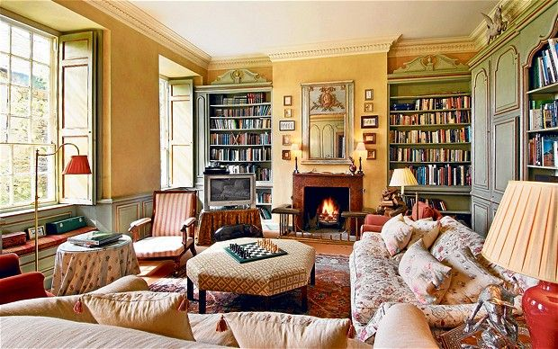 I need a library like this! Built in painted bookshelves, lots of sunlight, fireplace, rugs, & comfy furniture...and of course the window seat!