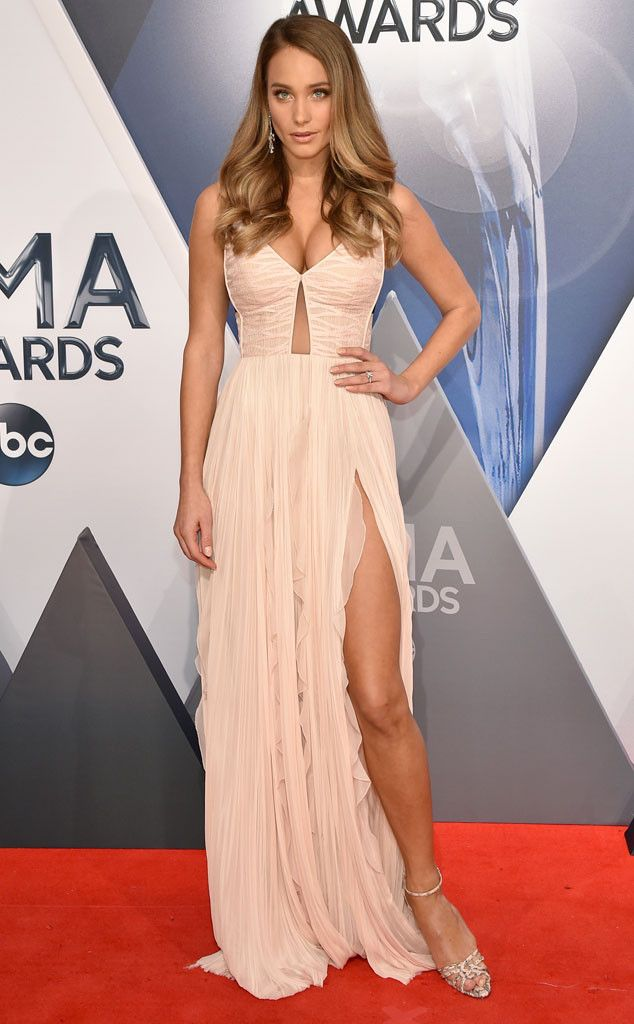 Hannah Davis from 2015 CMA Awards Red Carpet Arrivals. Holy hot! The newly engaged model is fierce in a cleavage-clad gown, and also shows off her massive engagement ring for the first time