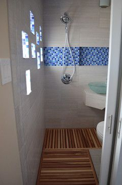 modern wet bathroom thatu0027s just 20 square feet teak flooring is a practical and warm choice for this wet bath