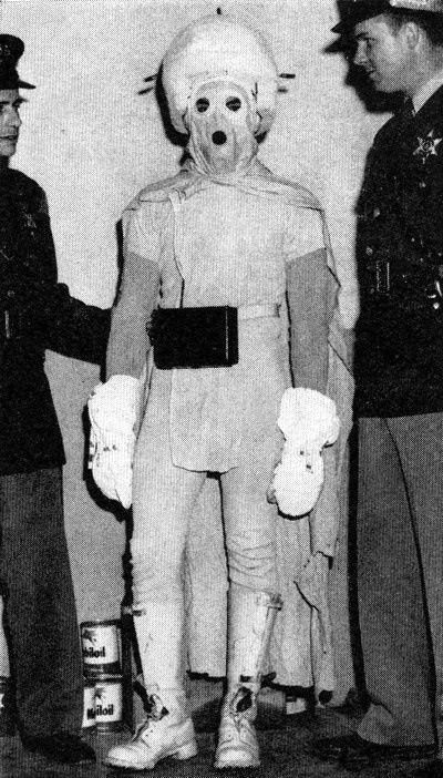 In April of 1958 people driving between Elkton and Bad Axe, Michigan began seeing a strange, blue figure with a cape and blinking helmet who would suddenly appear by the side of the road at night, cavort in the glow of the headlights, and disappear. He was described as anywhere from two and ten feet tall and able to run faster than an ordinary human being. One eyewitness claimed to have seen him perched on top of a telephone pole.