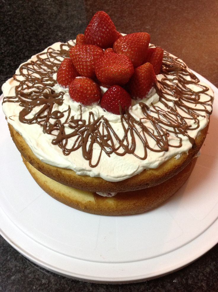 Naked strawberry and cream filled strawberry cake. Used a regular sponge, filled with strawberries and whipped cream, and topped it with more whipped cream and whole strawberries, then decorated with drizzled chocolate!