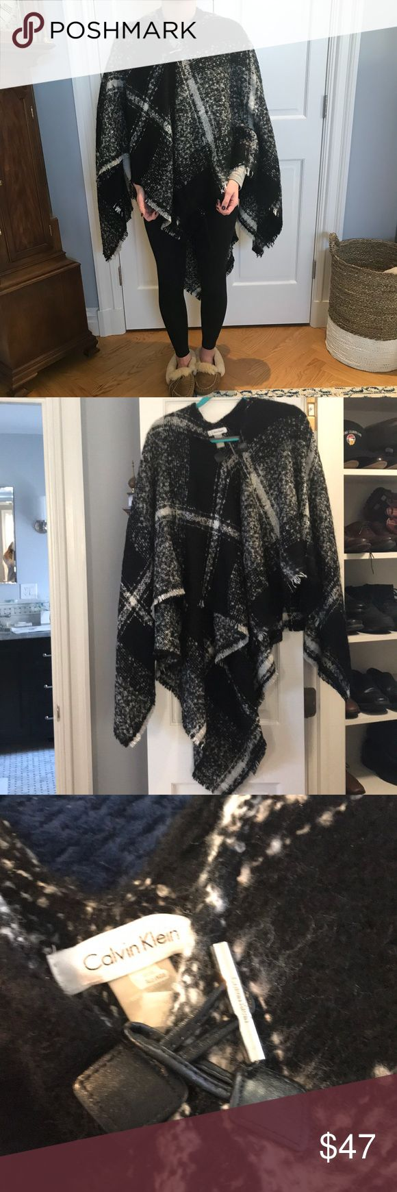 Black and white buffalo plaid cape Calvin Klein white and black buffalo plaid cape; can be worn opened or closed - toggle closure; 100% acrylic but feels like cashmere ; brand new with tags; very comfortable but also warm! Calvin Klein Sweaters Shrugs & Ponchos