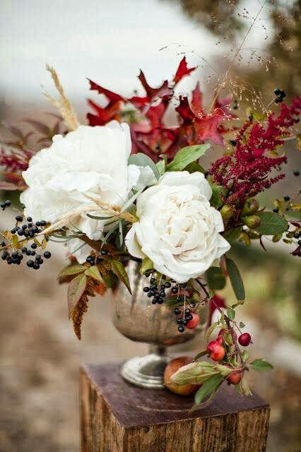 vignette design: Fall display - beautiful roses, common fall foliage and gatherings,  silver goblet like vessel