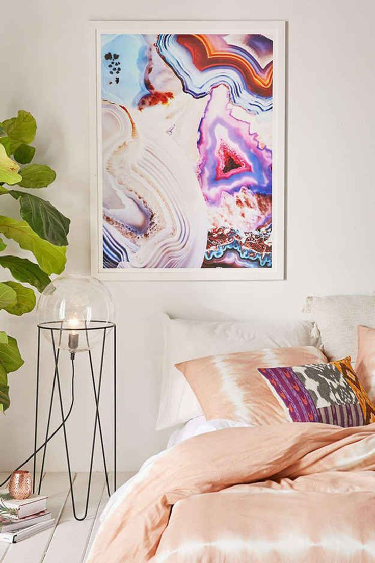 How about a piece of colourful agate art for your bedroom? This one is from Urban Outfitters and looks fantastically bohemian in combination with the tie-dye bedding and kelim cushion.