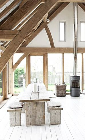 wood beams, white floor, fireplace and wood dining by Roderick James Architects