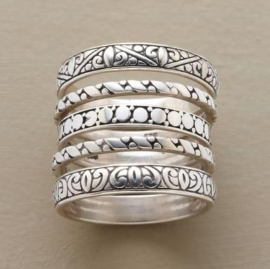"Five sterling silver rings, each hand cast with a different motif based on Victorian carvings. Whole sizes 5 to 10. Approx. 1/2"" wide worn together."