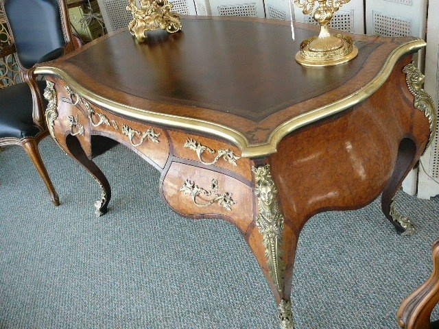 "This is a magnificent ""Uber Premium"" antique parquetry French Bureau Plat Desk Writing Table with an abundance of dore' bronze mountings and hardware plus several storage drawers. It is completely surrounded in inlaid parquetry. This is not only a very useful piece, it is truly gorgeous! $16,000 on GoAntiques"