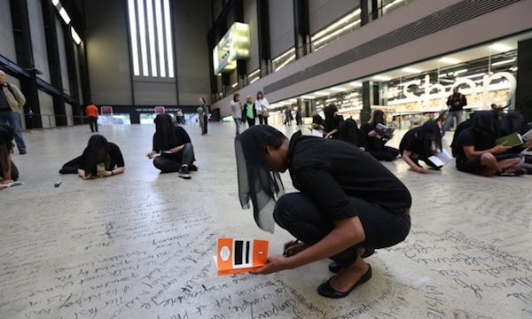"""Protesters participating in the 25-hour """"textual intervention"""" against BP at Tate Modern this weekendPhoto: Martin LeSanto-Smith via The Guardian"""