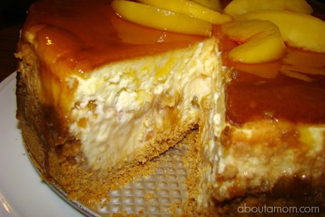 Fresh Peach Cheesecake ~  The New York style cheesecake has a hidden layer of sweet peach compote that is truly to die for. A gingersnap crust will put it over the top!  Recipe @: http://www.aboutamom.com/2013/08/fresh-peach-cheesecake-recipe.html