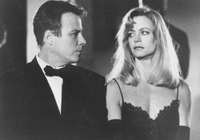 Goldie Hawn and John Heard in Deceived