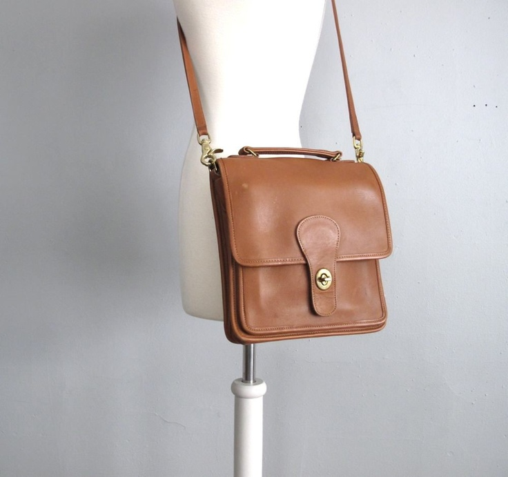 Camel leather vintage COACH cross-body. MAM find $10 w/o strap- had my shoemaker make a strap for me- perfect match! Used brass fittings from hardware store.....