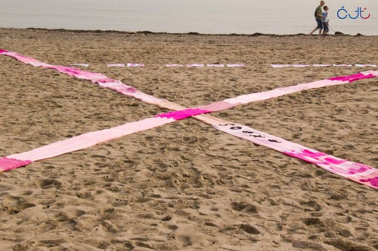 Fotogallery: la sciarpa ANDOS arriva in spiaggia
