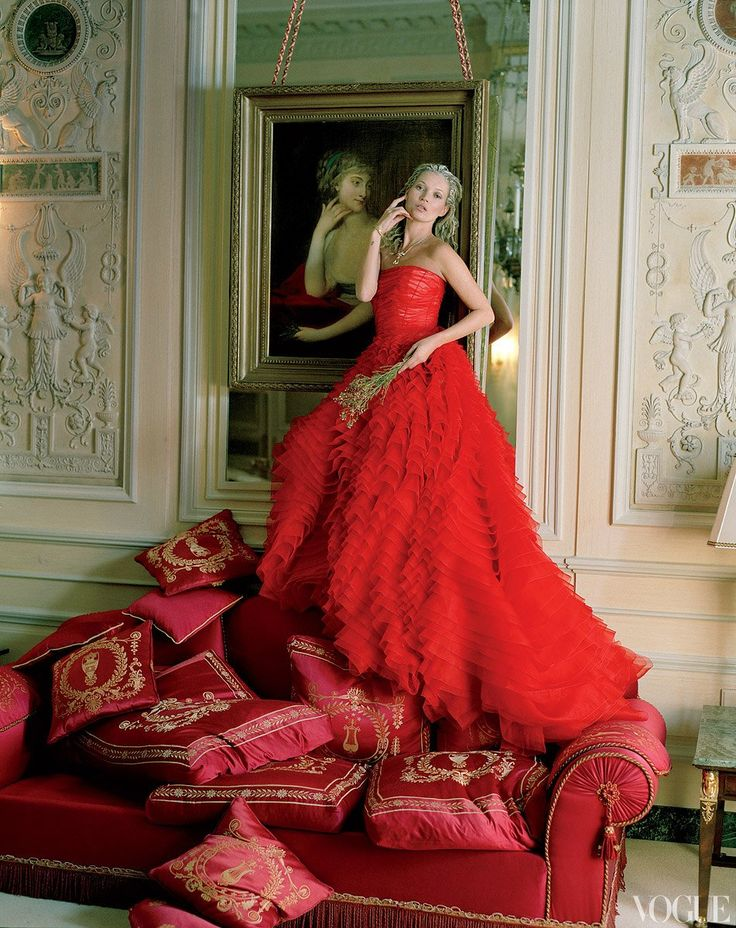 Life Imitates Art - Like the neoclassical crimson satin sofa, a dramatic tiered evening dress (Dior's finale look) adds a jolt of brilliant color to the hushed palette of an Imperial Suite salon. Dior Haute Couture silk dress.
