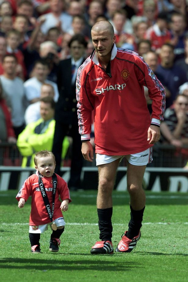 An adorable throwback picture of David Beckham with eldest son Brooklyn Beckham on Manchester United's Old Trafford football ground