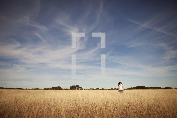 Woman on dry wheat field