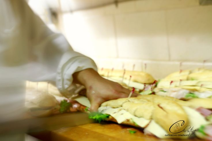 Hands at work prepping... www.christinecatering.com