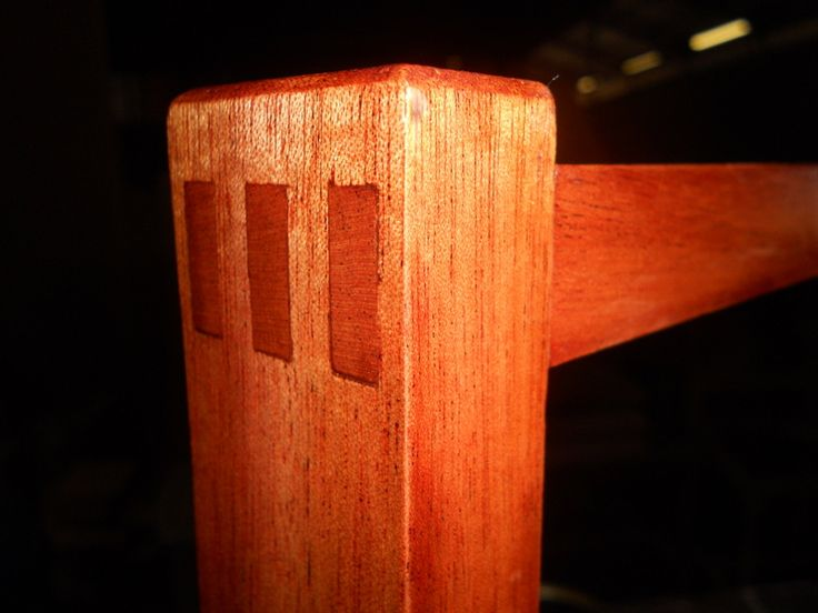 Three hand-cut through mortise-and-tenon joints in African mahogany.