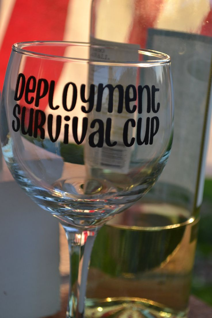 """Deployment Survival Cup  Clear wine glass with vinyl lettering 'deployment survival cup'. Wine glass measures 7 inches tall and 3 inches in diameter.  It's a comedic view on how a glass of wine might dull the pain of missing her husband or make the day of being a single parent a little more tolerable.    This is in no way advocating drinking as a means to cope with stress. It is simply a lighthearted take on dealing with deployments."" Love it! - MilitaryAvenue.com"