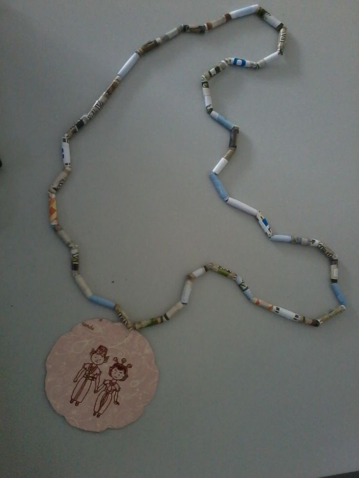 Dinda's necklace. It's made of old magazine paper, invitation card, and string