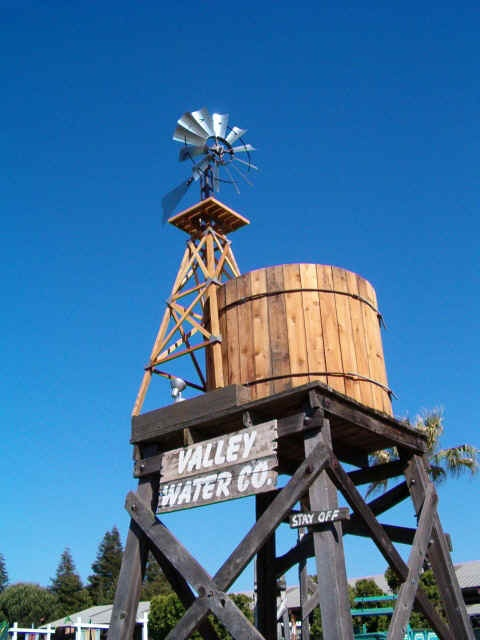 dual use tower - raise windmill height and elevate water tank on the same platform...