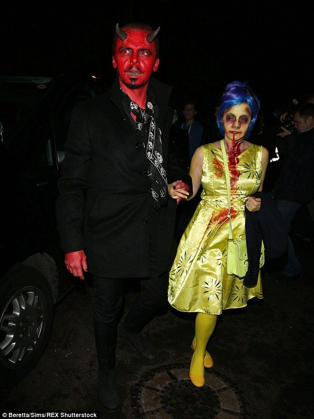 Dapper devil: Simon Pegg sported some bright red body paint for his demonic look as he arrived with wife Maureen