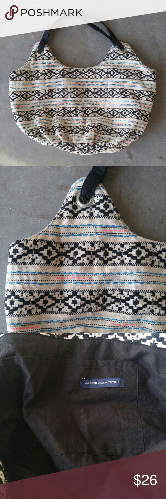 American Eagle Outfitters Tribal Print Tote Bag AEO tote bag in excellent condition! Black, white, pink, and blue striped tribal print. Black lining with one pocket. Snap closure. Please ask any questions. No trades. Make a reasonable offer. Thanks! American Eagle Outfitters Bags Totes