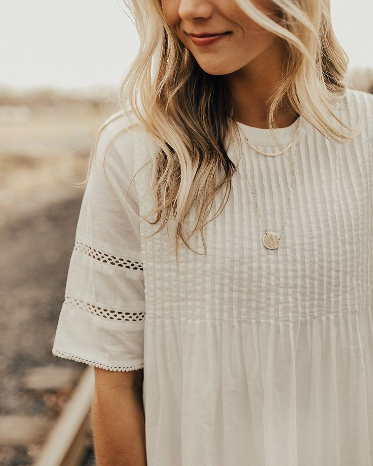 Love this top. Especially the color, the feminine detail and 1/2 sleeve