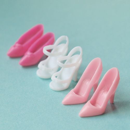 Barbie shoes... stepping on these things in the carpet, ouch!