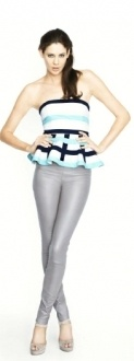 THE PEACEFUL STONE is a fitted, peplum top with stripe bind detail. Made from a