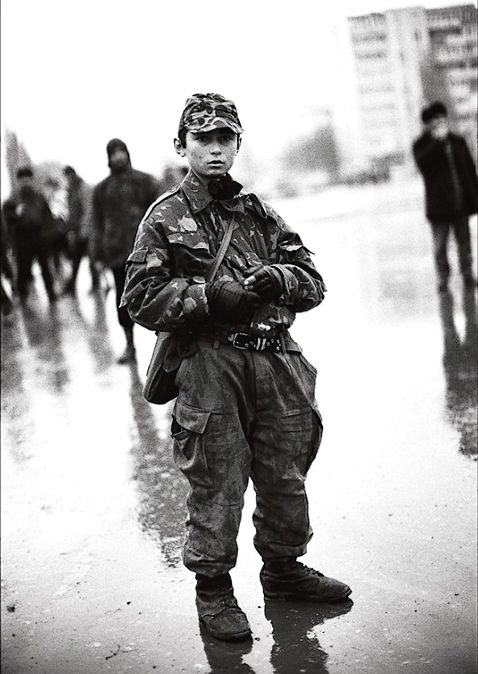 A young Chechen boy in Grozny, January, 1995. by Christopher Morris