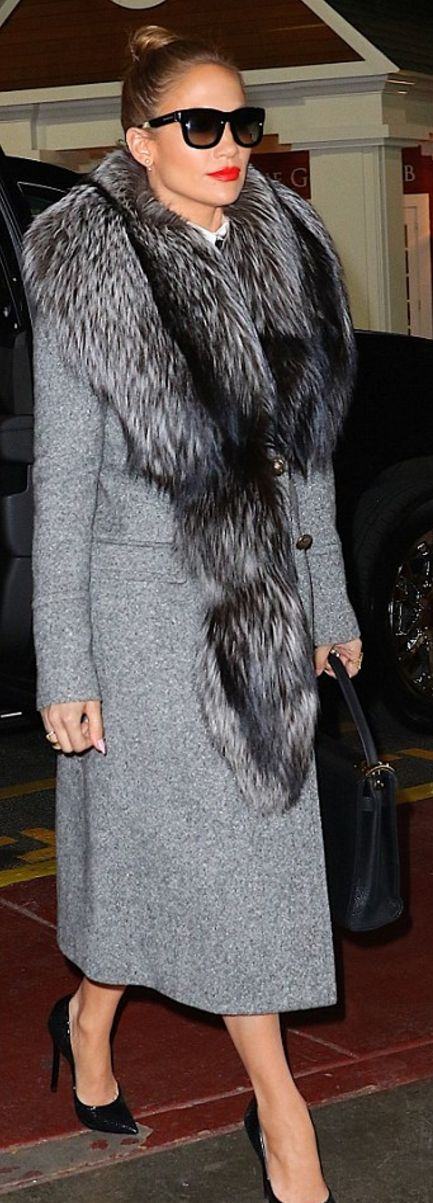 Jennifer Lopez in Coat – Roberto Cavalli  Purse – Valentino  Shoes – Casadei