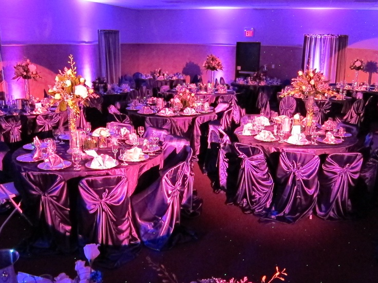 The most popular color for up lights at a wedding now and check out the table clothes and chair covers