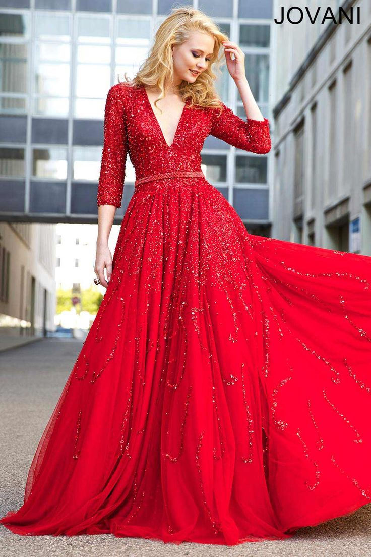 Vibrant red A-line three-quarter sleeve dress features a plunging neckline and beaded embellishments