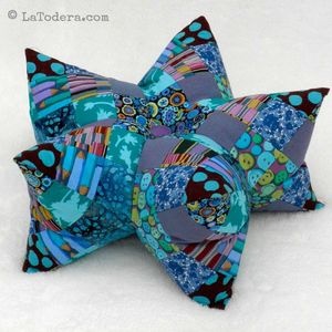 Patchwork Star Pillow and Pincushion Pattern by La Todera. DIY 3D star pillow here shown in blue.