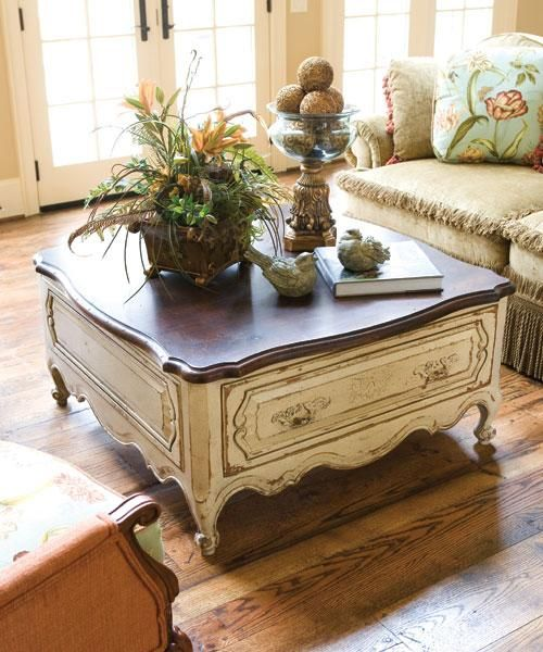 French country coffee table by Habersham homes. painted table with wood top