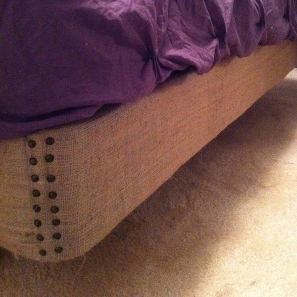 Upholstered boxspring with burlap and added studs! No Bedskirt needed anymore! What a great idea!