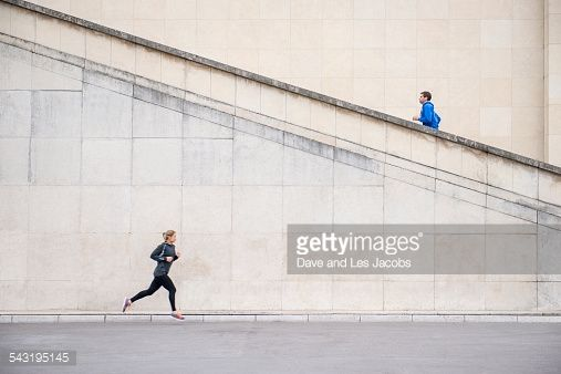 Stock Photo : Caucasian runners jogging near staircase