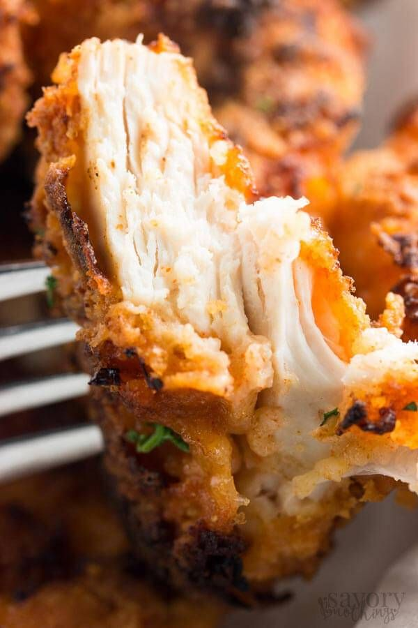 Everyone will love this crispy oven fried chicken recipe - it's so simple to make but so full of flavor! Serve it with the sides of your choice for a new family-favorite dinner!
