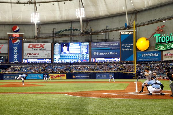 Brett Gardner Photos Photos - Pitcher Chris Archer #22 of the Tampa Bay Rays delivers the first pitch of the 2017 MLB season to Brett Gardner #11 of the New York Yankees during the first inning of their Opening Day game on April 2, 2017 at Tropicana Field in St. Petersburg, Florida. - New York Yankees v Tampa Bay Rays