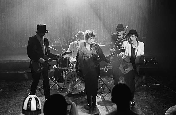 The French popular band Telephone performing on the musical show Cotton Club From left to right guitarist Louis Bertignac bassist Corinne Marienneau...