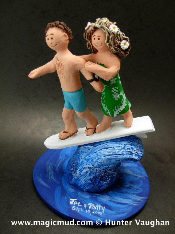 Surfing Bride and Groom Wedding Cake Topper    Surfing Wedding Cake Topper, custom created for you! Perfect for the marriage of a Surfer Groom and his Bride!    $235   #magicmud   1 800 231 9814   www.magicmud.com